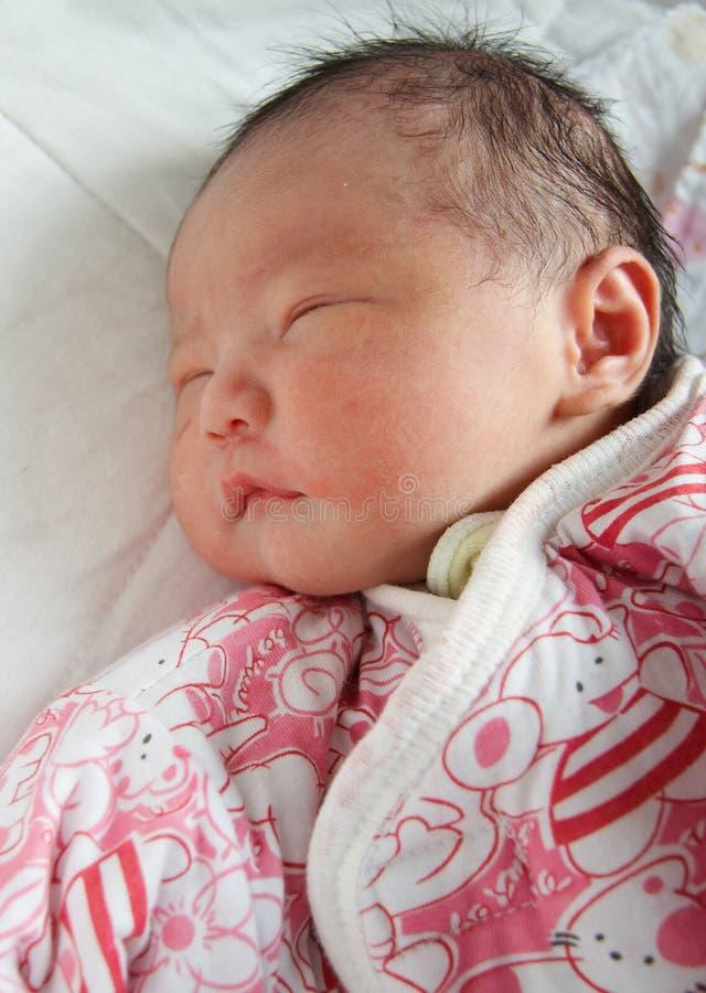Newborn baby. A cute asian newborn boy sleeping royalty free stock photography