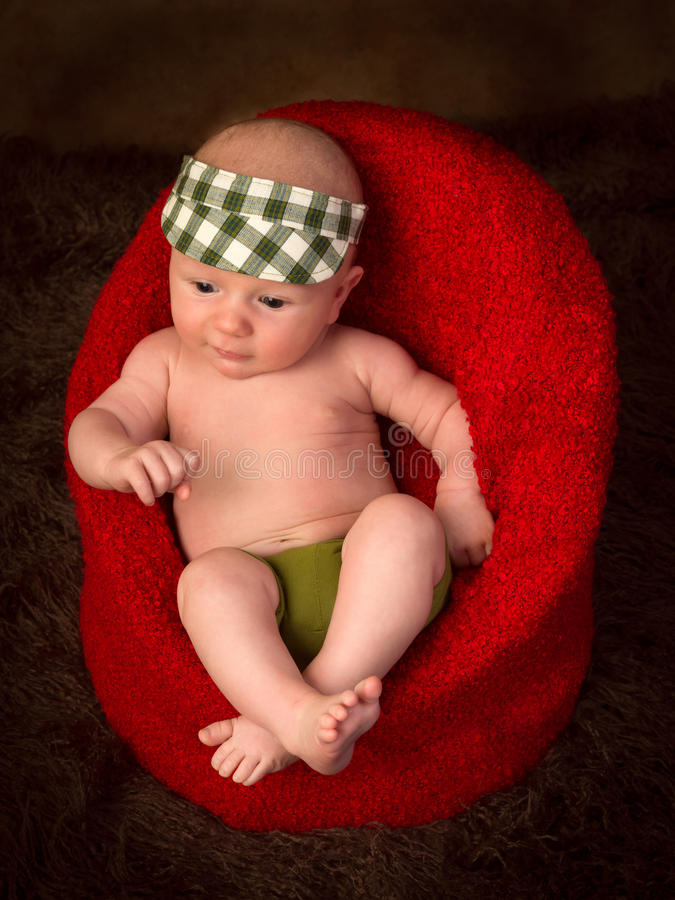 Newborn baby in armchair stock images