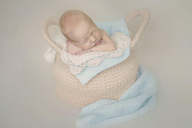 Newborn baby in basket stock photo