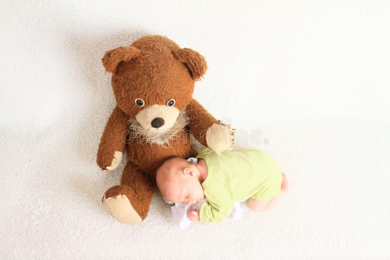 Newborn baby boy sleeping on Teddy bear royalty free stock image