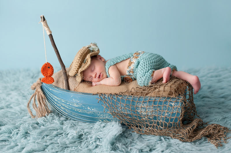 Newborn Baby Boy in Fisherman Outfit stock image