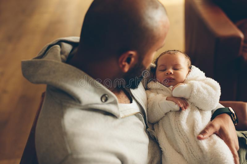 Newborn baby boy in his father`s arms stock photo