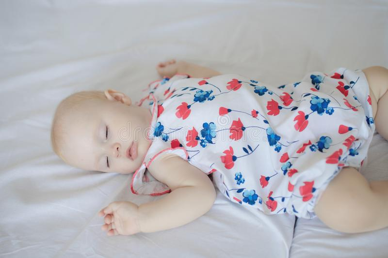 Newborn baby boy lying on bed stock photography