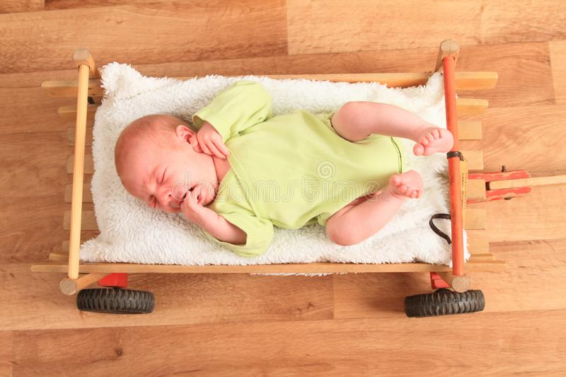 Newborn baby boy lying in carriage royalty free stock image