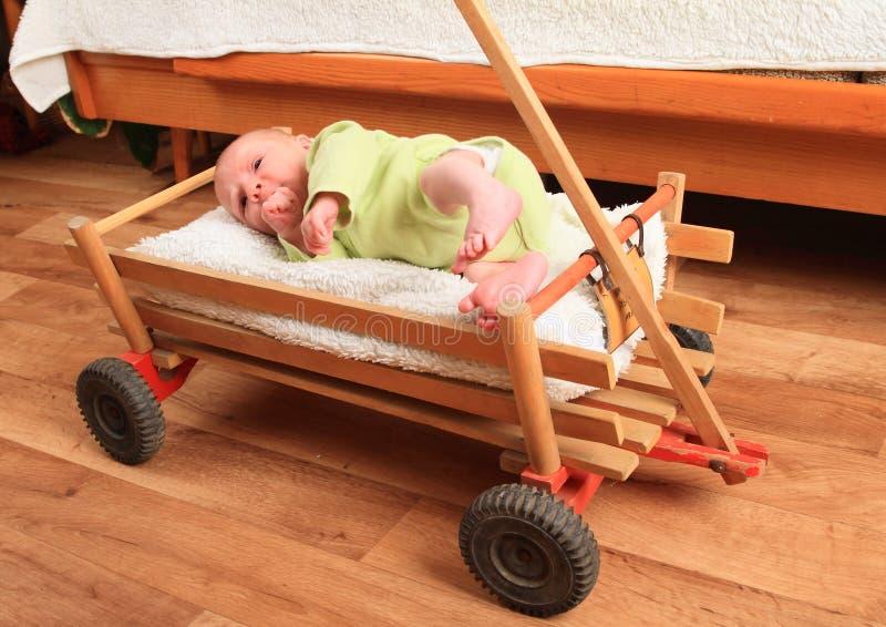 Newborn baby boy lying in carriage royalty free stock photos