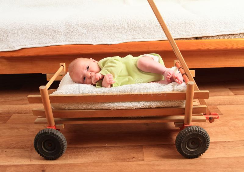 Newborn baby boy lying in carriage stock photos