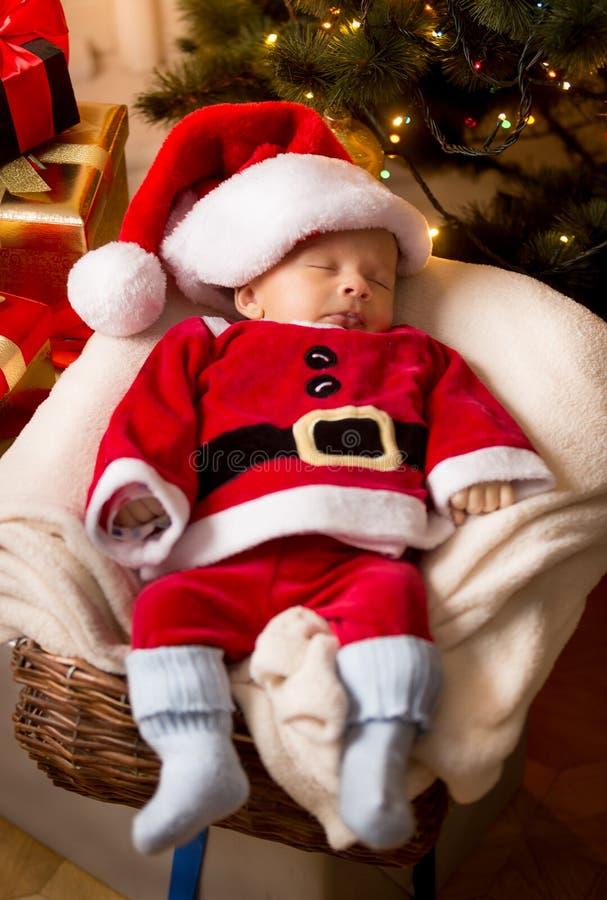 Download newborn baby boy in santa claus costume sleeping in basket stock image image of