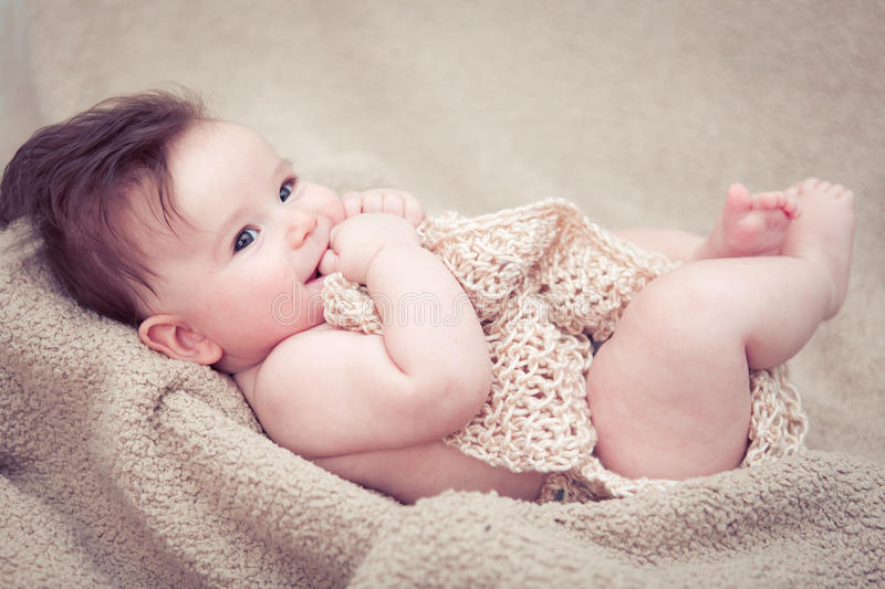 Newborn baby boy smiling stock photography
