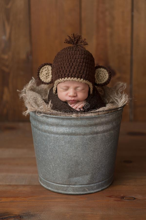 Newborn Baby Boy Wearing a Monkey Hat royalty free stock photos