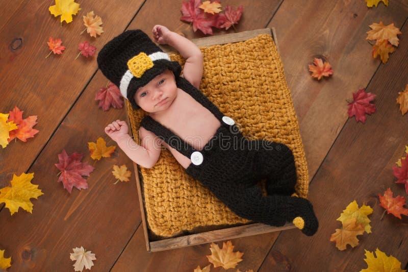 Newborn Baby Boy Wearing a Pilgrim's Costume royalty free stock images