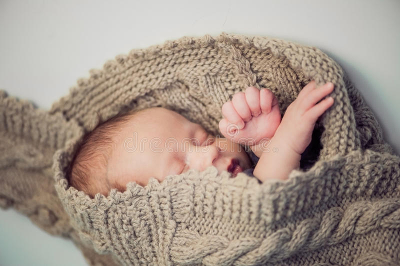 Newborn baby boy, knitted Newborn baby boy wrapped in a knitted royalty free stock images