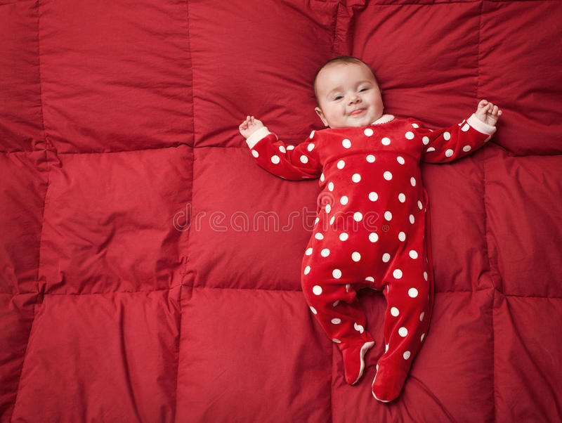 Newborn baby with Christmas suit stock images
