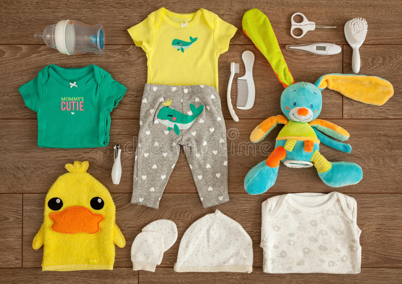 Newborn Baby Essential Stuff and Accessories in a Flat Lay Composition on Wooden Table royalty free stock photos