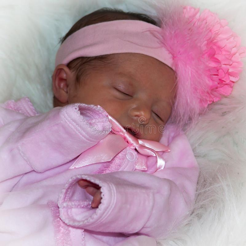 Newborn Girl in Pink stock images