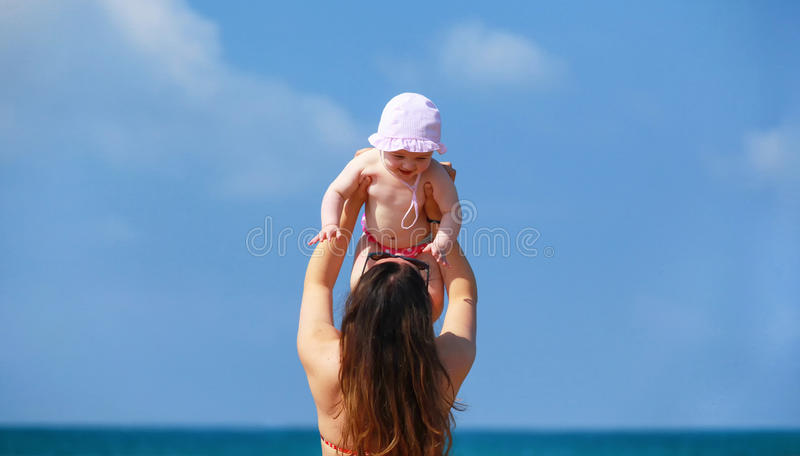 Newborn baby girl playing with mom. royalty free stock photos