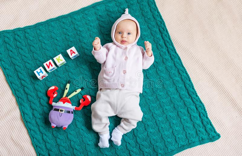 Newborn baby girl posed on blanket. Top view stock photography
