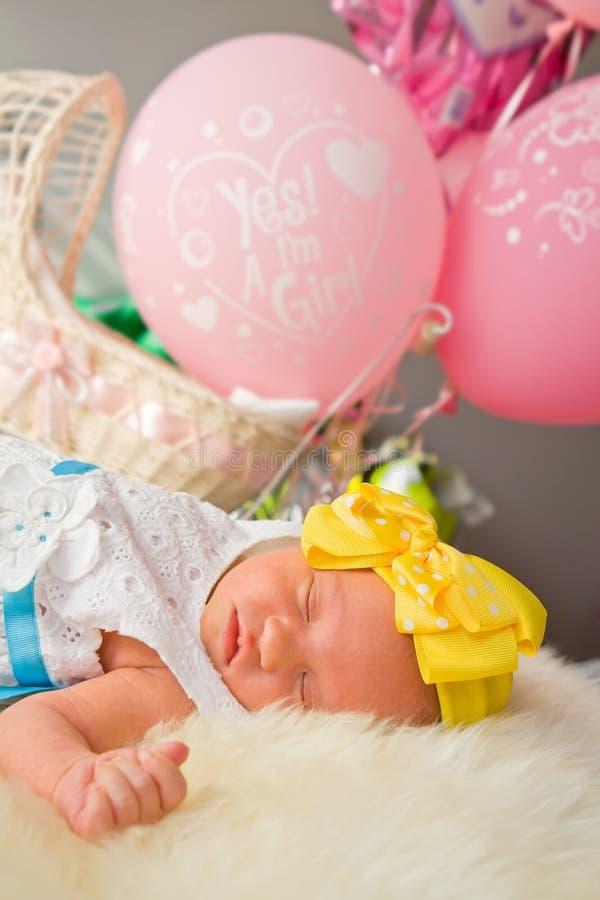 Newborn Baby Girl Sleeping on Fluff stock photo