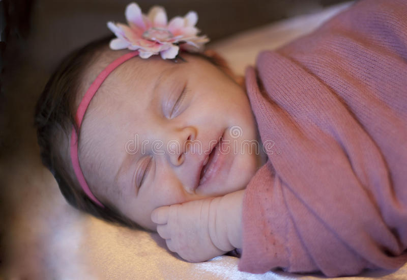 Newborn baby girl smiling stock image