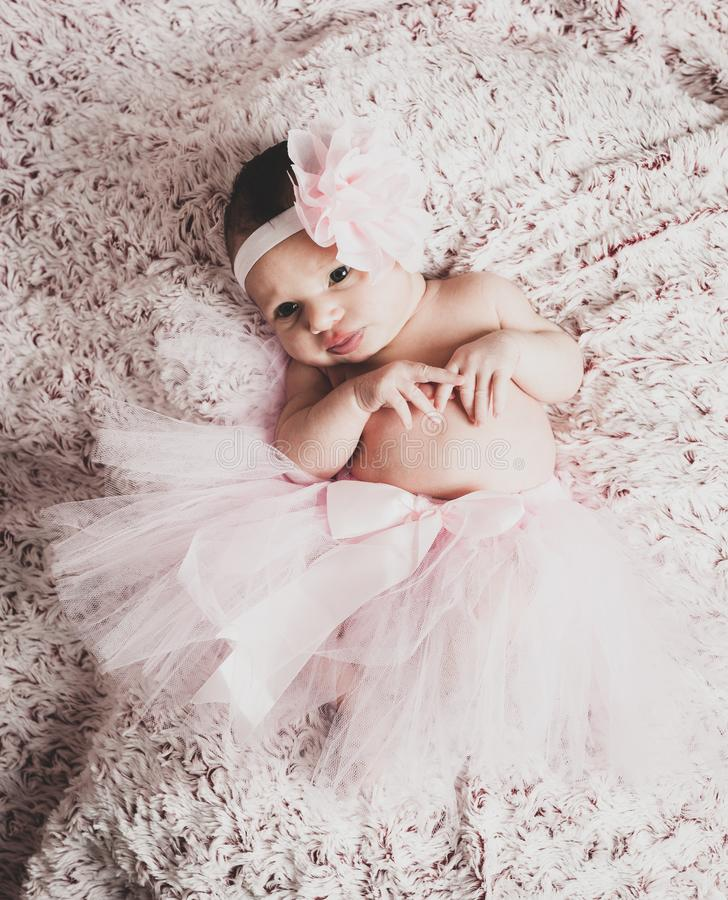 Newborn baby girl wearing a pink ballerina tutu royalty free stock photography