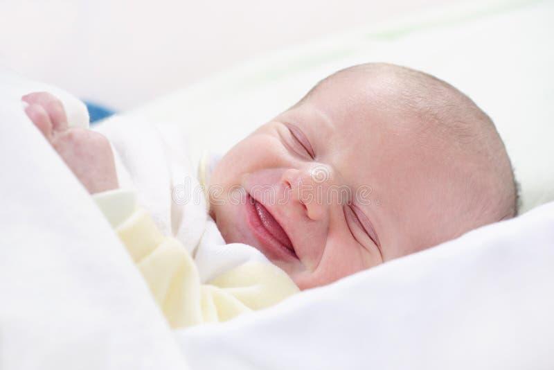 Newborn baby laughing stock image