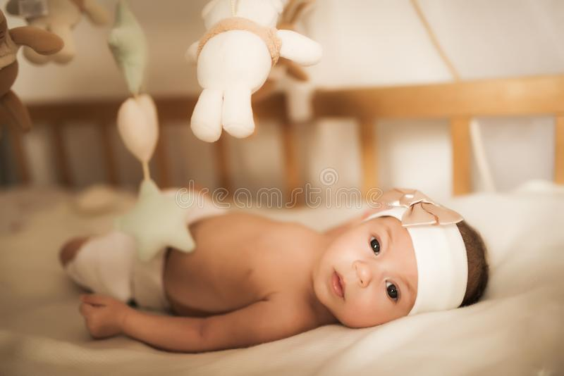 Newborn Baby Lies In The Crib Among Toys Stock Image ...