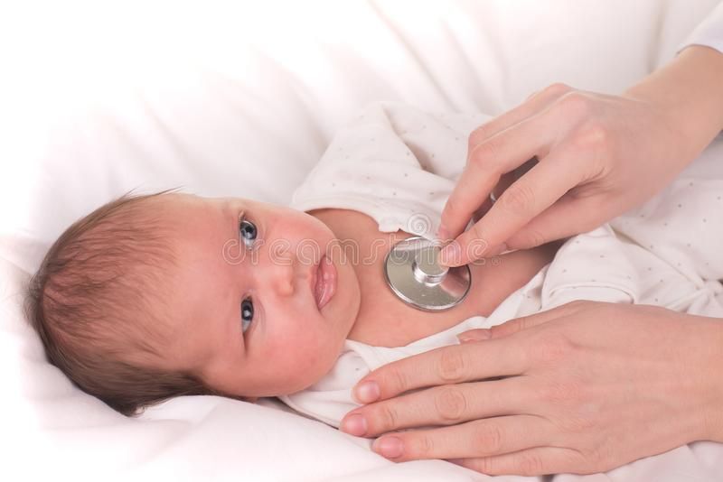 Newborn baby. Little child in medicine hospital. Medical health care. Doctor pediatrician. stock images