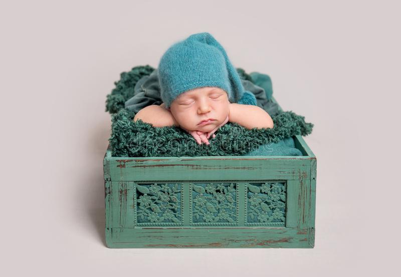 Newborn baby lying in wooden crate royalty free stock photos