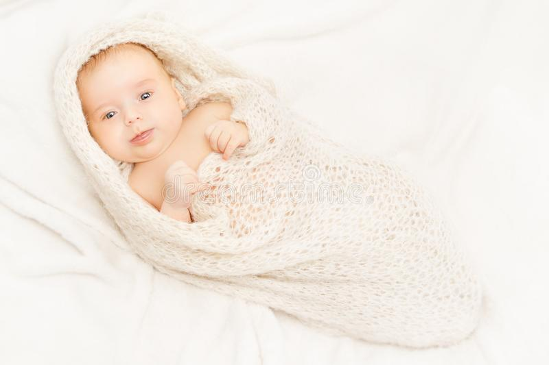 Newborn Baby, New Born Kid Swaddled in White Blanket, one month royalty free stock image