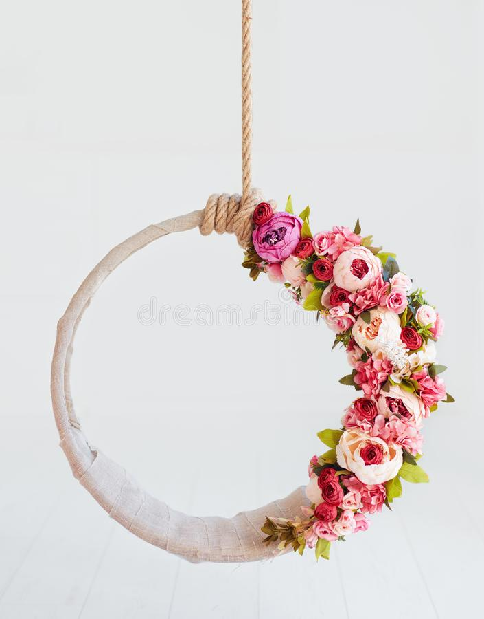 Newborn baby photography swing, DIY floral hanging hoop. Newborn baby photography swing, DIY tender floral hanging hoop frame stock photos