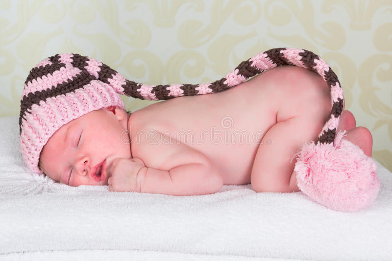 Newborn baby with pompom hat stock photography