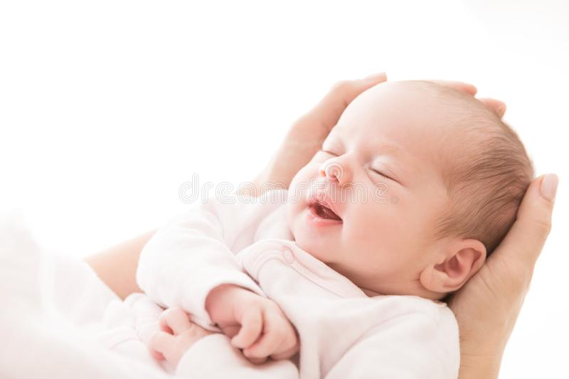 Newborn Baby Sleep on Mother Hands, New Born Girl Smiling and Sleeping. Happy Two Weeks Old Child on White royalty free stock image