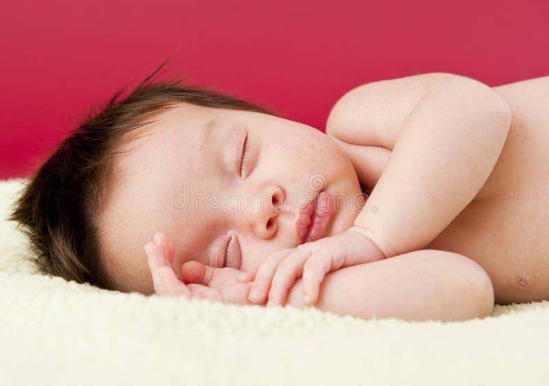 Newborn baby sleeping. On its side royalty free stock image