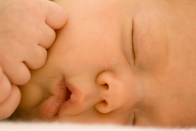 Newborn Baby Sleeping. Closeup of adorable newborn baby girl peacefully sleeping stock photography