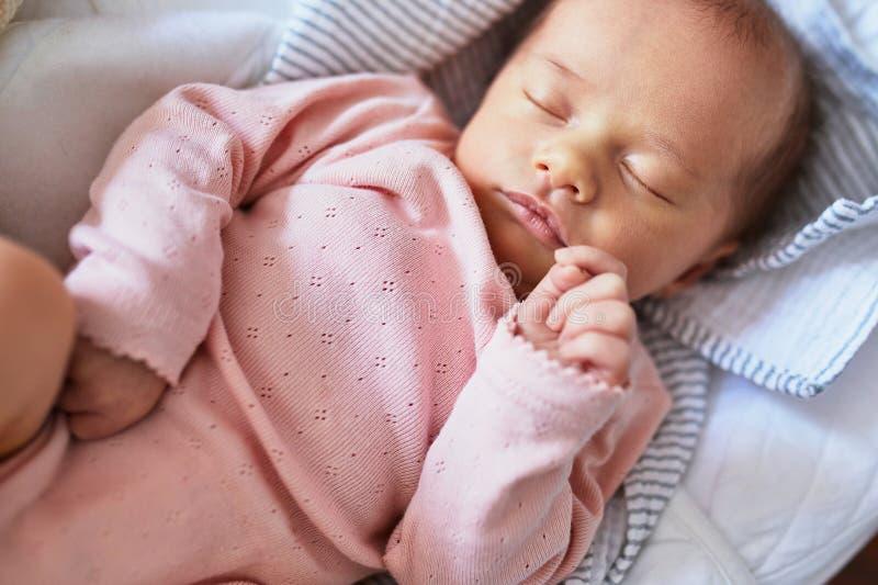 Newborn baby sleeping. Newborn baby girl sleeping peacefully in the crib stock photos