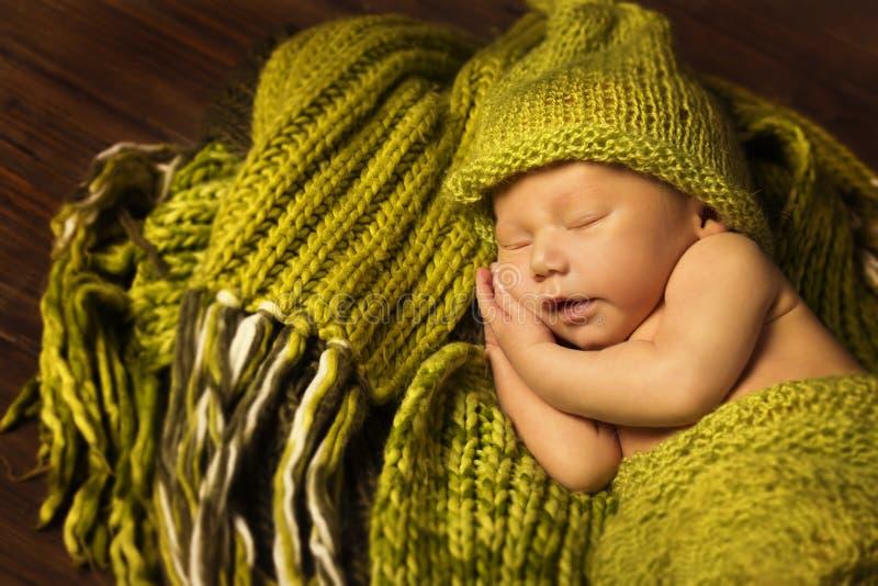 Newborn Baby Sleeping, New Born Kid Sleep in Green Woolen. Blanket stock photo