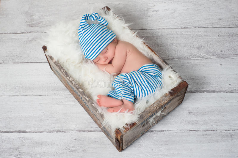 Sleeping Newborn Baby Wearing Pajamas royalty free stock images