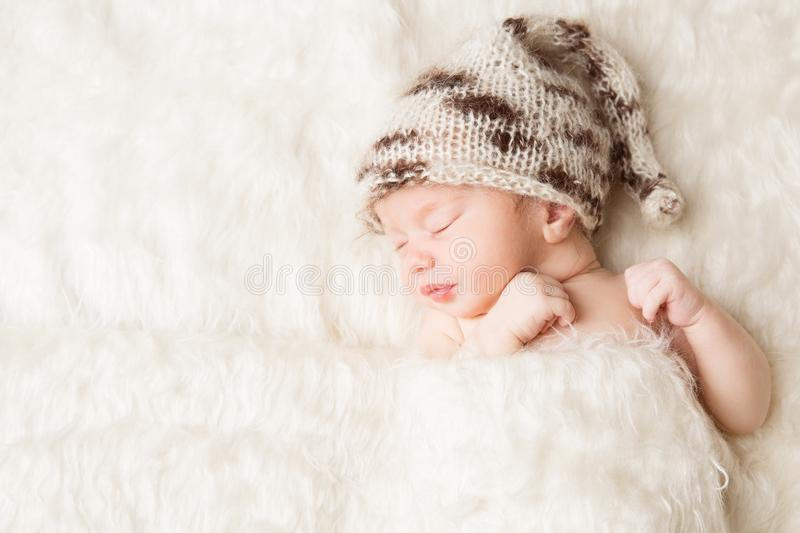 Newborn, baby sleeping in white bed, beautiful new born infant portrait. In hat on white background stock photos