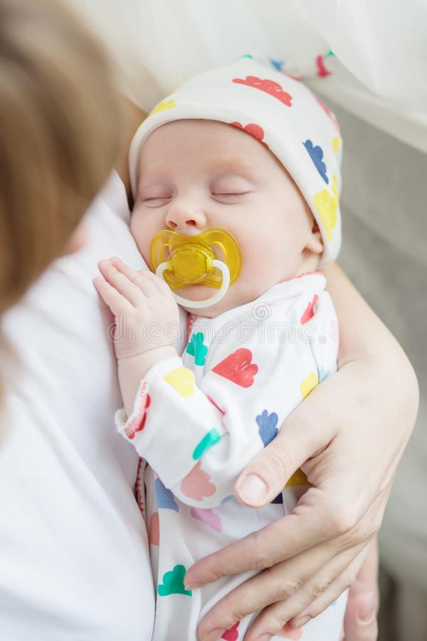 Newborn baby sleeps with a pacifier sleeping royalty free stock image