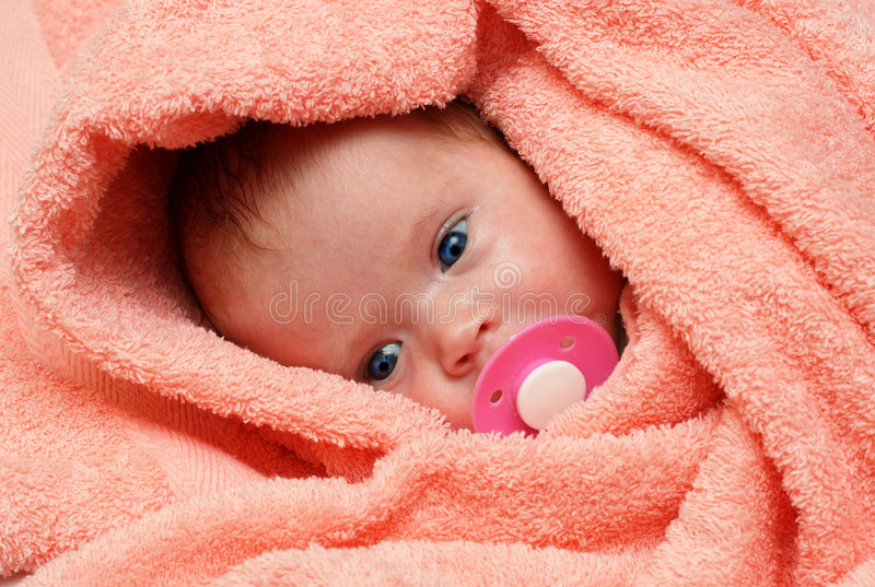 Newborn baby with soother stock photo