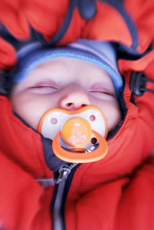 Download Newborn Baby With Soother In Winter Clothes Stock Photo - Image: 12152382