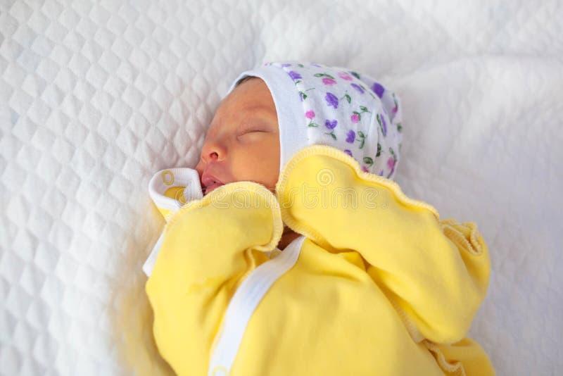 Newborn baby sucks a tongue. Newborn baby sleeps sweetly. New li. Newborn baby sucks a tongue. Newborn baby sleeps sweetly with handles pressed to the chest. New royalty free stock photography