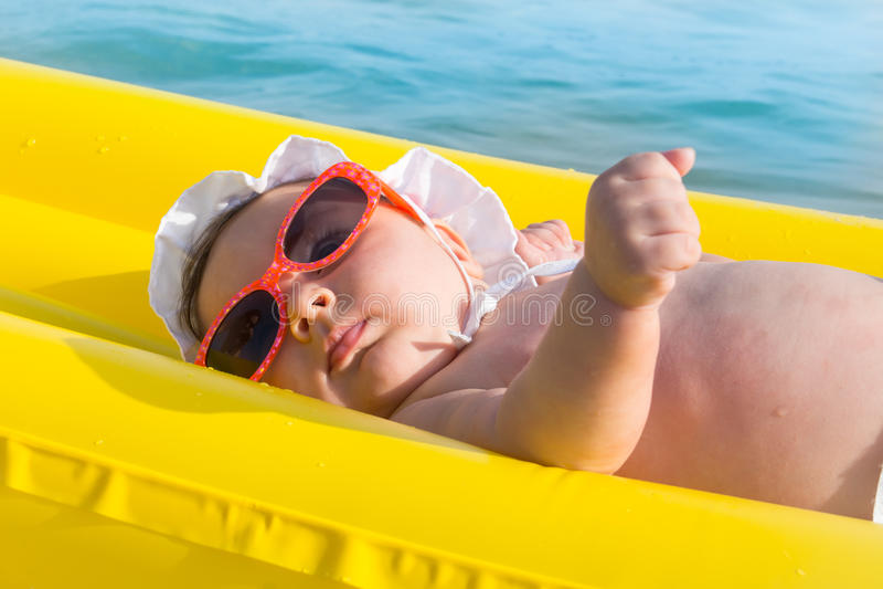 Newborn baby on summer mattress stock photos