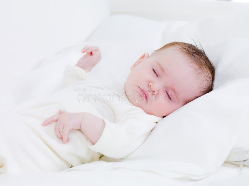 Newborn baby in sweet dreams stock image