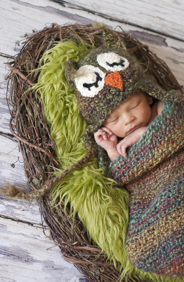 Newborn boy with owl hat royalty free stock photography