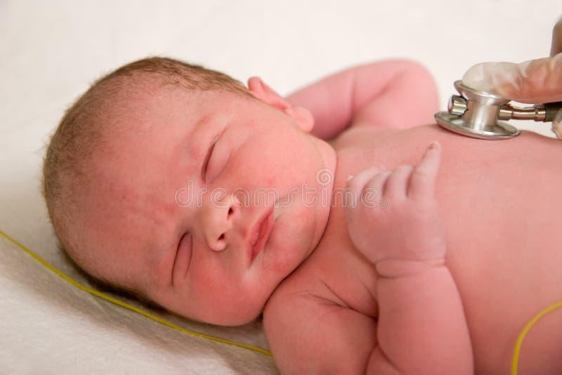 Newborn exam stock image