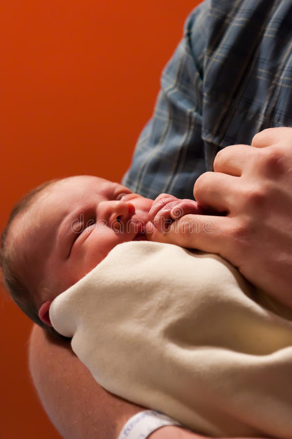 Newborn girl close-up in father's hand royalty free stock images