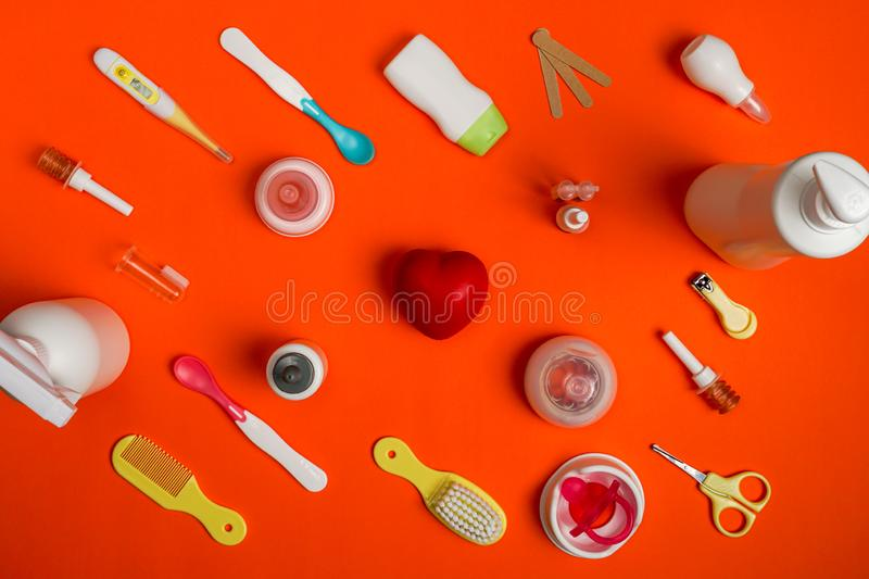 Newborn healthcare kit and baby utensils, top view stock images