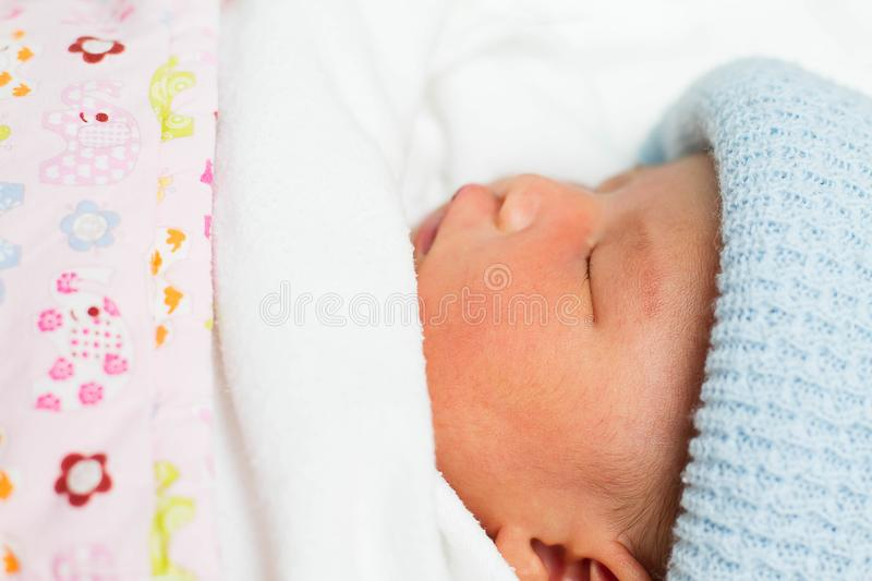 Newborn infant baby girl sleeping in bed royalty free stock images