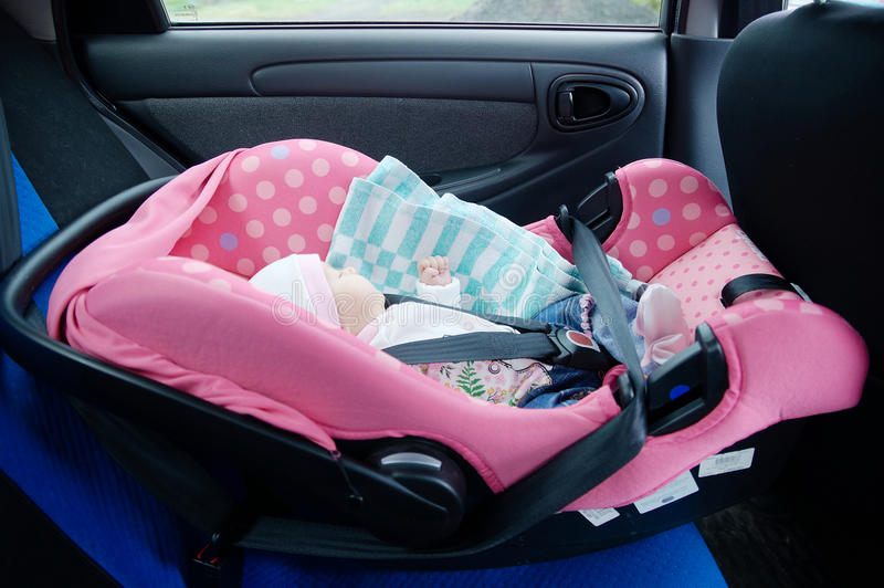 Newborn sleeping in car seat.Safety concept. Infant baby girl. secure driving with children. Baby care lifestyle. Cute baby. Sleeping in car stock photography