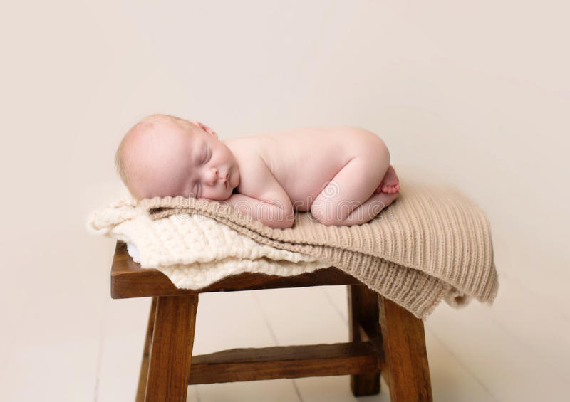 Newborn Sleeping on Chair royalty free stock image
